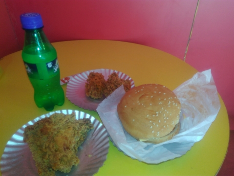 Chicken Hot 'n' Crunchy, Piri-piri Crunch and Veg Burger and soft drink